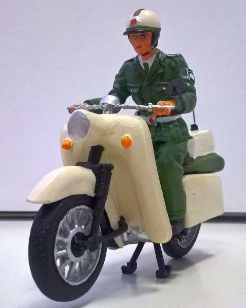 DDR Polizist auf Motorrad